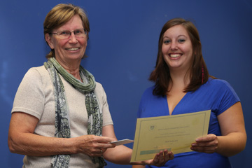 Elizabeth Moll recieving her award for Best Academic Performance in the PGDipLIS 2014